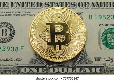golden bit coin lay on face side  one  dollar  bill