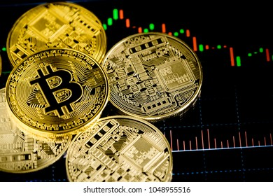 Golden Bit coins place on stock graph background.