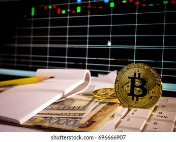 Golden bitcoin with banknote and stock market grap conceptual for crypto currency background.
