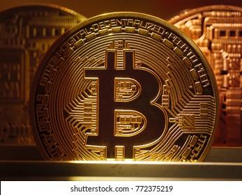 Golden bitcoin BTC coin macro closeup.