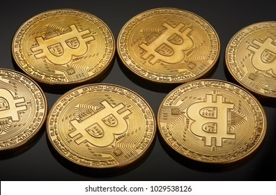 Golden bitcoin coin. Crypto currency golden coin bitcoin symbol on black background.