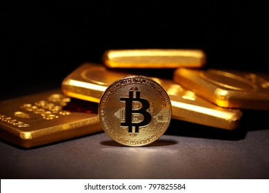 Golden Bitcoin Coin and Gold Bars. Bitcoin cryptocurrency. Business concept.