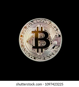 Golden bitcoin coin isolated on black background