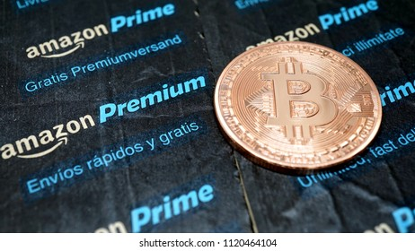 golden bitcoin coin on Amazon Prime label in detail