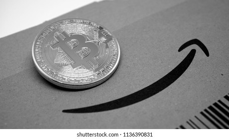golden bitcoin coin on Amazon cardboard with the famous smile logo