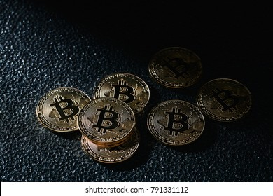 Golden bitcoin coin on the black background.