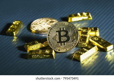 Golden bitcoin coin on the carbon Sheet.