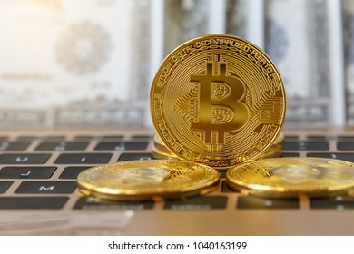 Golden Bitcoin coin on keyboard in background,  Cryptocurrency digital bit coin in hand, virtual money concept