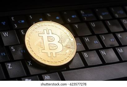 Golden bitcoin  coin  on laptop  keyboard