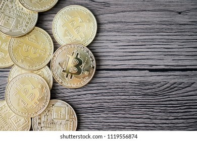 golden bitcoin coin on the wooden table