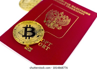 Golden bitcoin coin and passport of Russian Federation isolated on white background