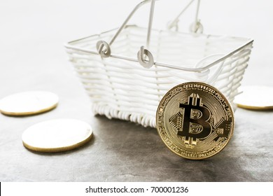 golden bitcoin coin with shopping basket crypto Currency online shopping background concept.