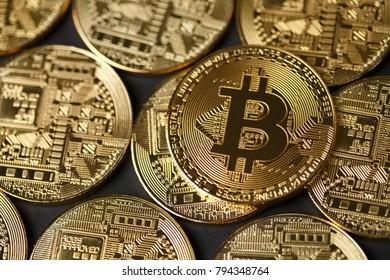 Golden Bitcoin coins closeup