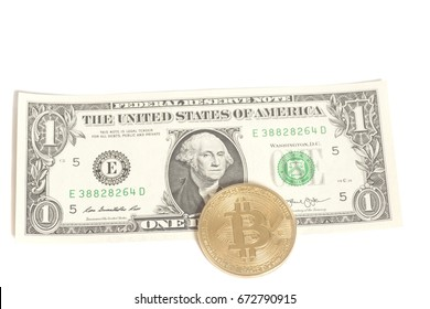 Golden bitcoin coins on one U.S. dollar isolated on white