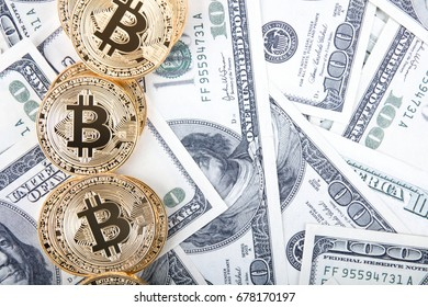 Golden bitcoin coins on us dollars. Close up