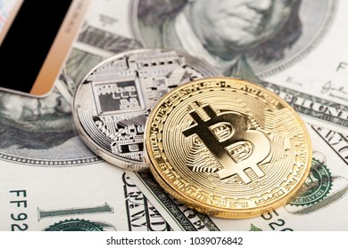 Golden bitcoin with credit card on top of dollar banknote background, new currency, accepting bitcoin for payment, finance concept