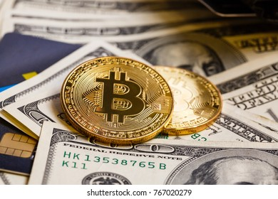 Golden bitcoin with credit card on top of dollar banknote background new currency accepting