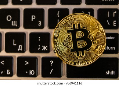 Golden bitcoin cryptocurrency on laptop keyboard. Cryptocurrency concept