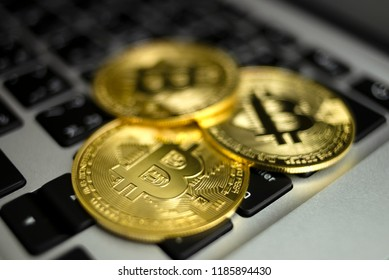 Golden bitcoin cryptocurrency on us dollars close up