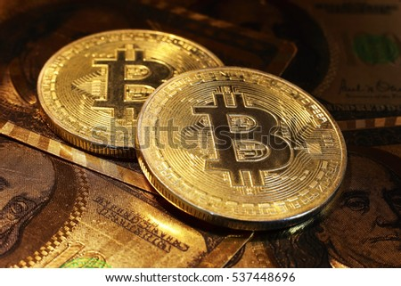 Golden bitcoin with dollar background. 