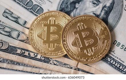 Golden Bitcoin and dollar banknotes
