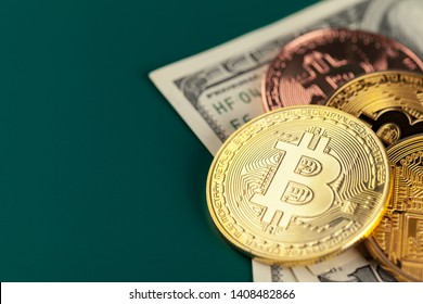 Golden bitcoin and dollars. close up