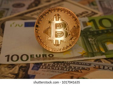 Golden bitcoin with euro and us dollars