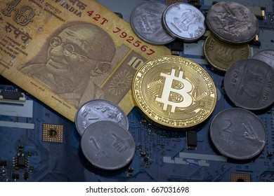 Golden  bitcoin and indian rupee money  on a chipboard. Bitcoin - official Indian payment.