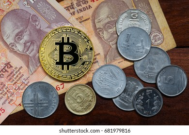 Golden  bitcoin and indian rupee money. Bitcoin - official Indian payment.