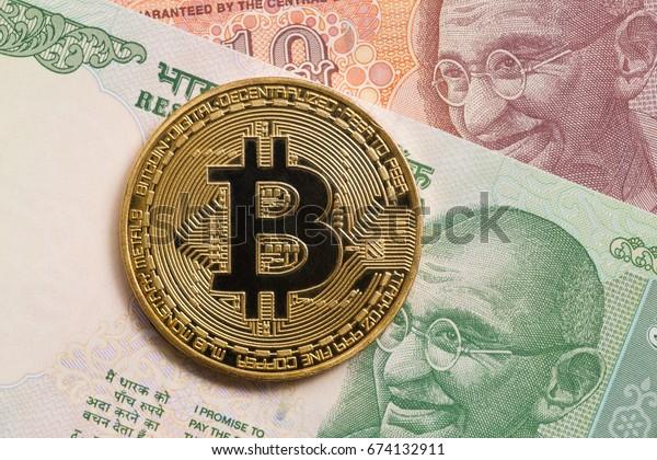 Golden  bitcoin and indian rupee money