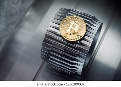 Golden bitcoin lies on the metal gearwheel. Digital Crypto currency revolution.