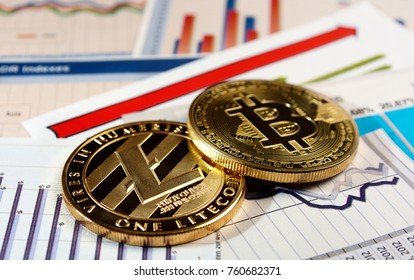 A golden bitcoin and litecoin on graph and diagrams background. concept of trading crypto currency
