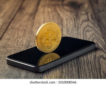 golden bitcoin model on mobile phone