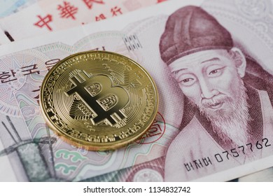 Golden bitcoin on 1000 South Korean won currency with copy space. Cryptocurrency or Asia economy business concept.