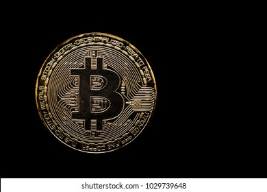 Golden bitcoin on black background. Bitcoin cryptocurrency.