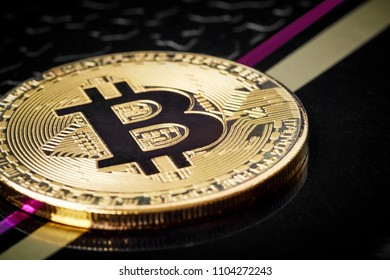 Golden bitcoin on a black background with lines