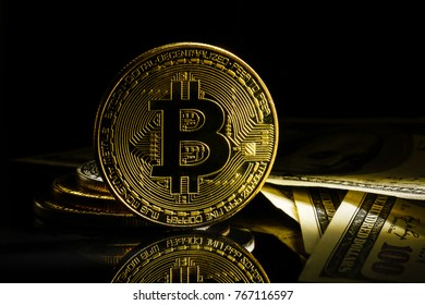 Golden bitcoin on black background with copy space cryptocurrency mining concept