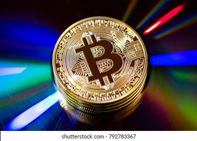 Golden bitcoin on black background. Bitcoin cryptocurrency (first decentralized digital currency).