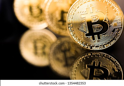 Golden Bitcoin on black backround. New virtual money. crypto currency