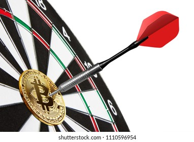 Golden Bitcoin on a dartboard with dart, isolated on white