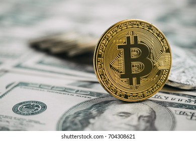 Golden bitcoin on dollar banknote background, modern currency concept