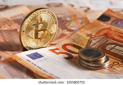 Golden bitcoin on fifty euro banknotes background. Bitcoin crypto currency, Blockchain technology, digital money, Mining concept, bitcoin on 50 euro bill.