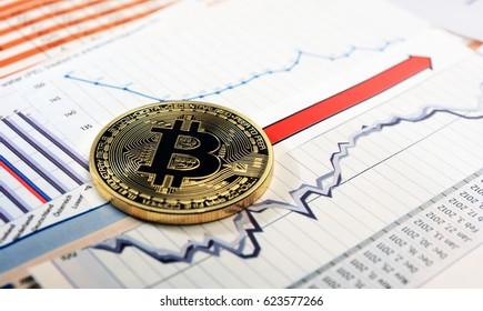 A golden bitcoin on graph and diagrams  background. concept of trading  crypto currency