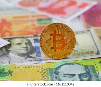 Golden Bitcoin on International banknotes background, Exchange Currency concept