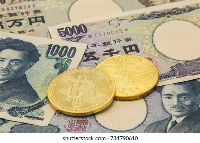 Golden bitcoin on japanese Yen banknotes background. Mining, Electronic money exchange concept, Conceptual image of bitcoin mining and trading, Accepting bitcoin for payment, Finance, Digital money