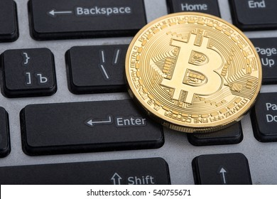 golden bitcoin on keyboard