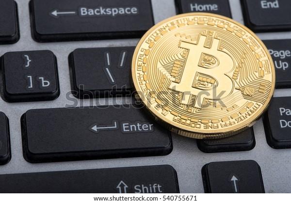 golden bitcoin on keyboard
