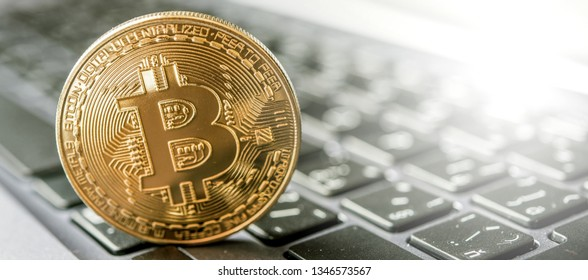 golden bitcoin on keyboard. Crypto currency