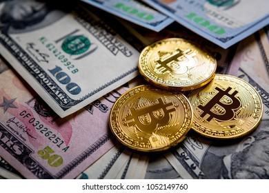 golden bitcoin on money bills background