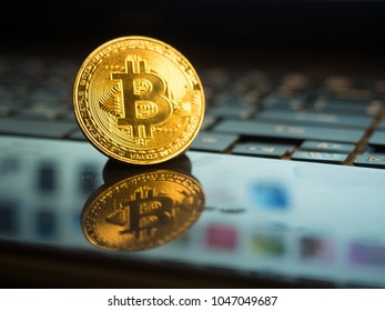 golden bitcoin on notebook background